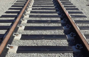 a railroad track with crossing tie pads
